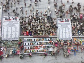 wall of dolls bruciato milano